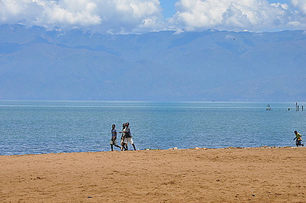 Friends On The Shore Of Lake Tanganyika, Mountains Of The Congo Behind
