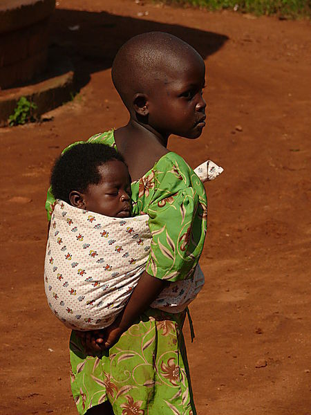 Girl Carrying Sister