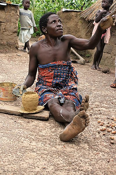 Woman making beer pots to sell at market