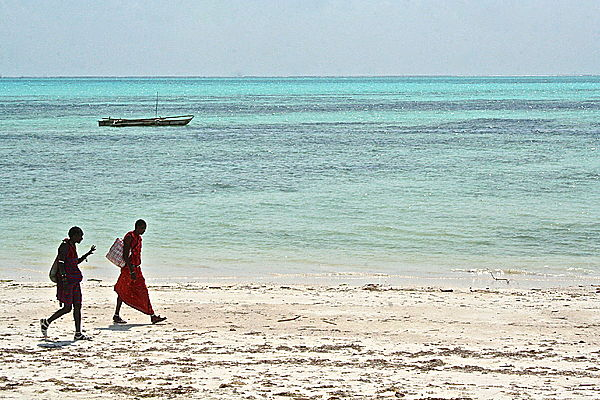 Red against blue: Masai boys in Zanzibar